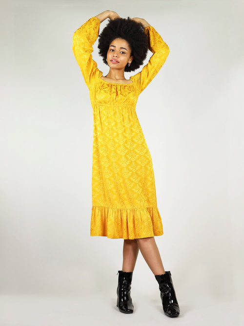 Mustard yellow empire dress in size XS. Pleated bottom and loose fit overall. Long sleeve with elastic at the cuffs. Ankle length and elastic around the cleavage and under the bust.