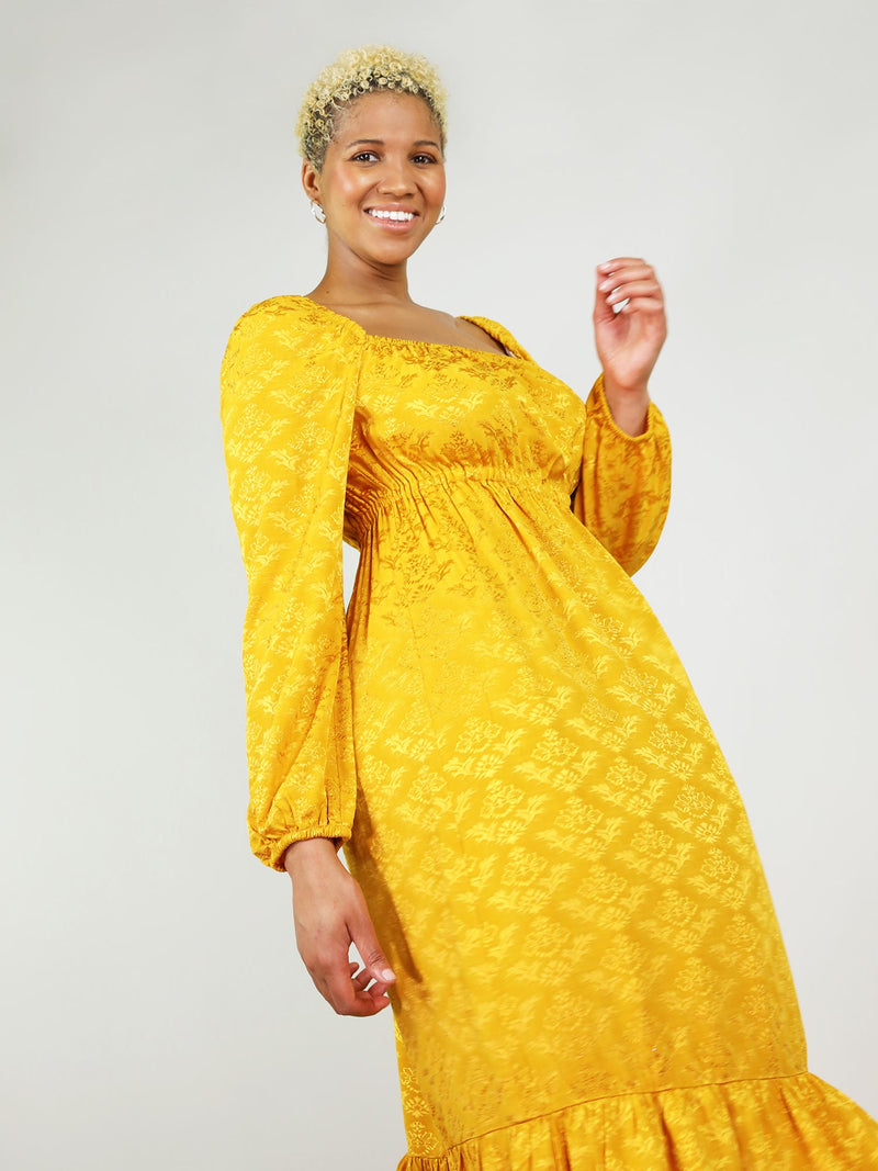 Loose fit with elastic around cleavage, shoulders, and cuffs. Mustard yellow empire dress is elegant and made from delicate fabric.
