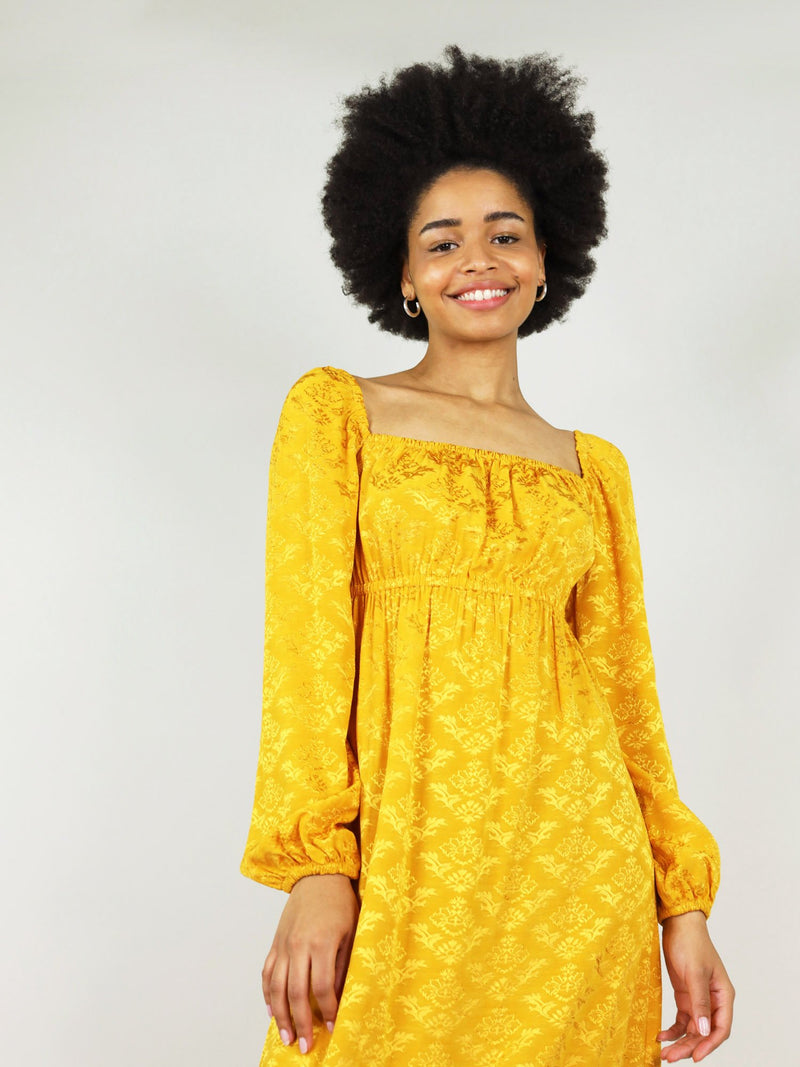 Square neck and relaxed fit, the empire dress is an elegant dress from beautiful mustard yellow fabric. Elastic under the bust and at the cuffs.