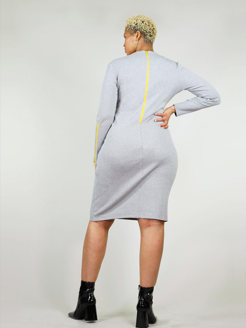 Back shot of the grey wicked zip dress with tight body con fit. Under knee length and long sleeves with bright yellow neon zip from neck to waist that unzips.