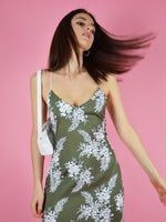 Close up of blonde gone rogue's floral slip dress in green.