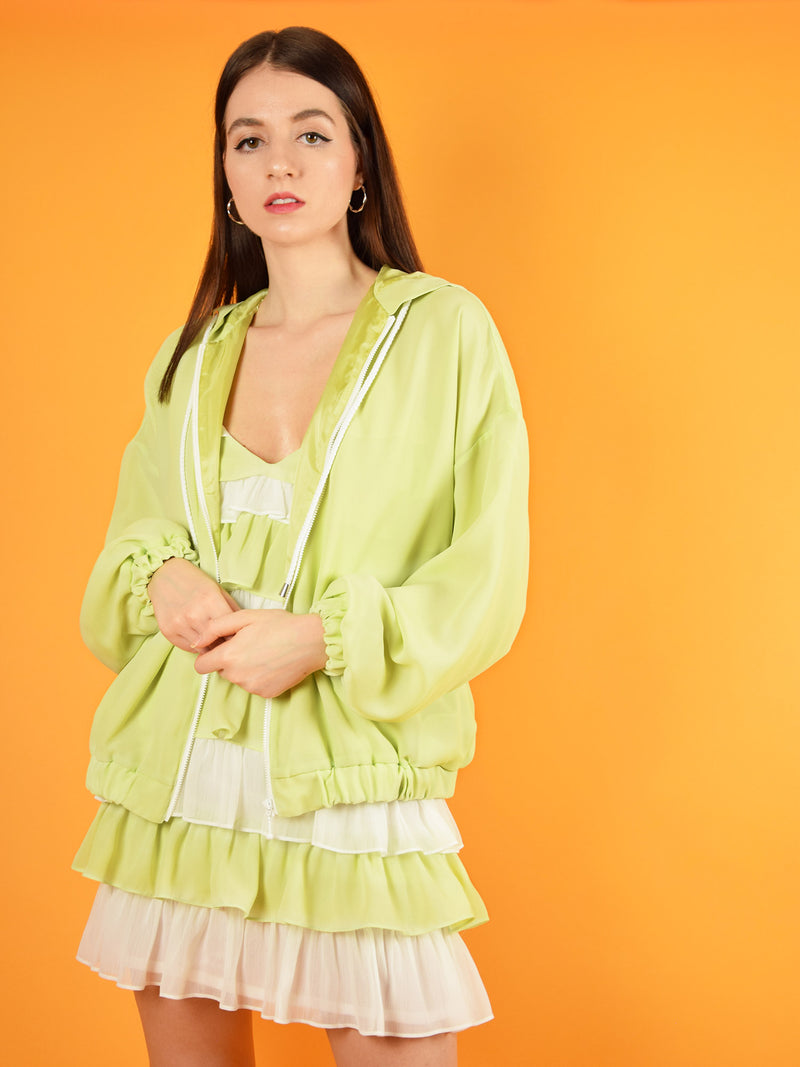 The sustainable summer affair mini dress in white and green and the chiffon bonfire jacket in green. A perfect outfit for chilly summer evenings.