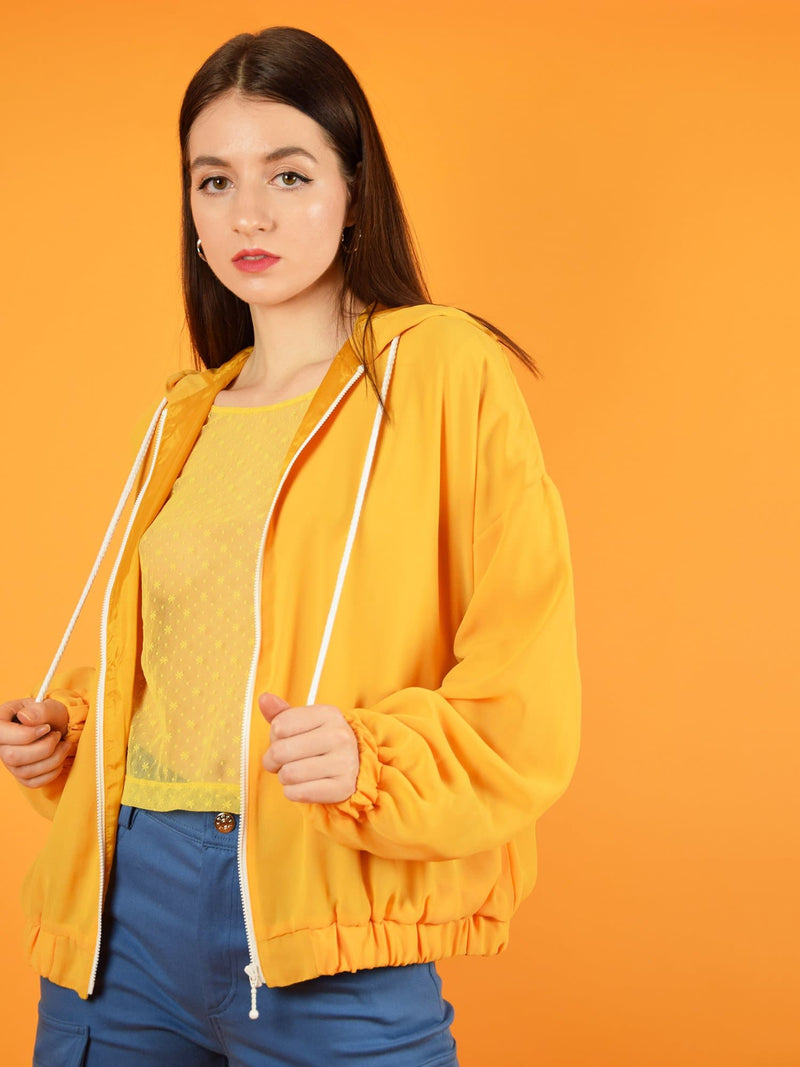 blonde gone rogue's bonfire sustainable bomber jacket in orange. The jacket has a loose, comfortable fit and is perfect for spring, autumn and chilly summer evenings.