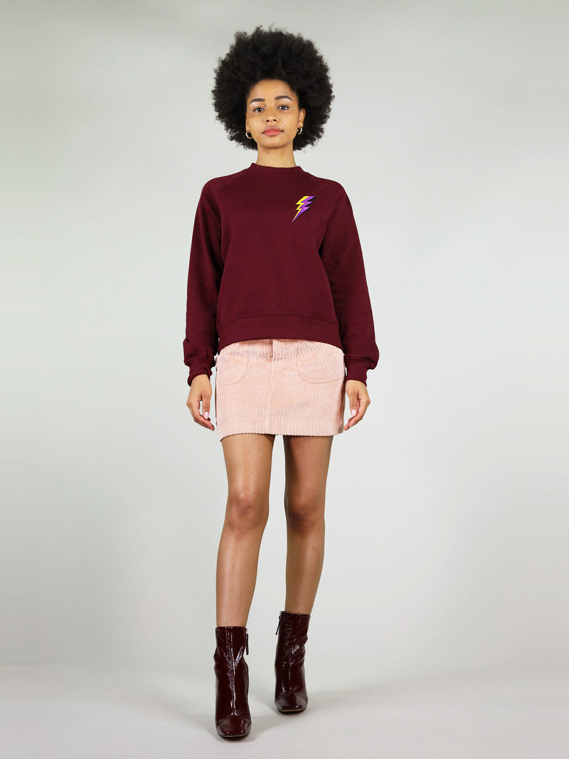 Very cosy and warm, the thunder organic sweatshirt comes in deep burgundy with slightly oversized fit. It is 100% organic cotton and has thunder embroidery in purple and yellow on the chest.
