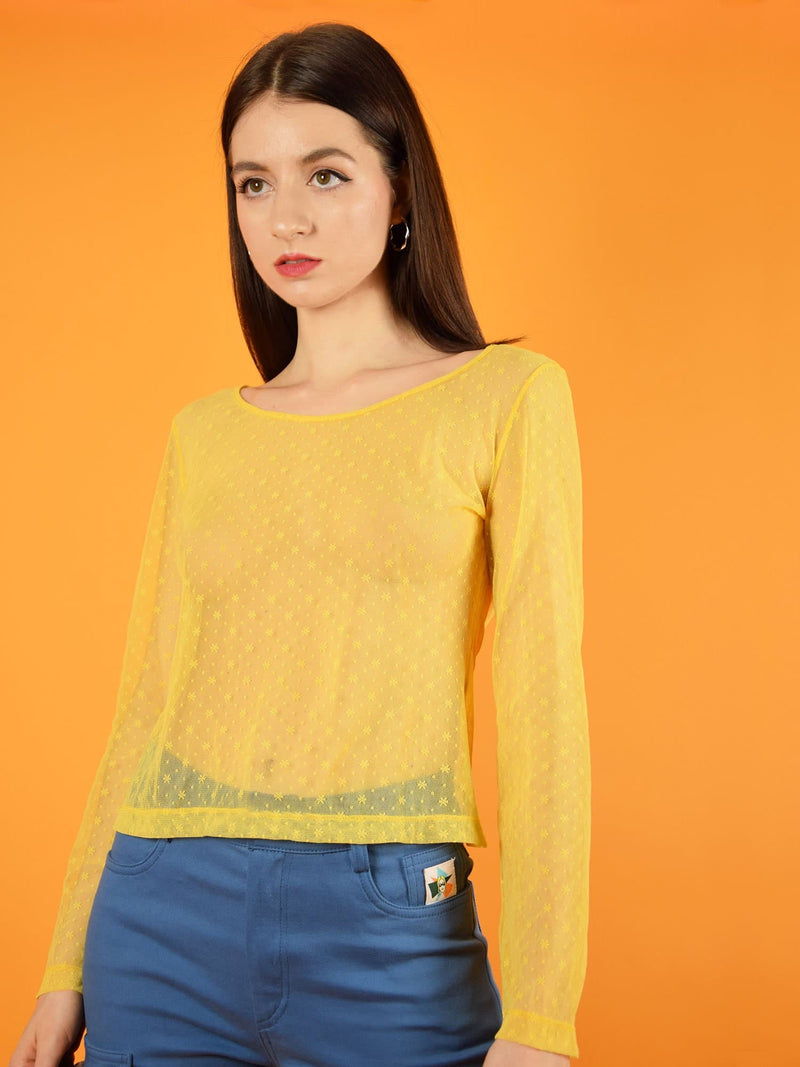 The yellow lace top with long sleeves is a cool match with high-waisted skinny jeans. It is slightly transparent and has a beautiful floral lace. designed by blonde gone rogue