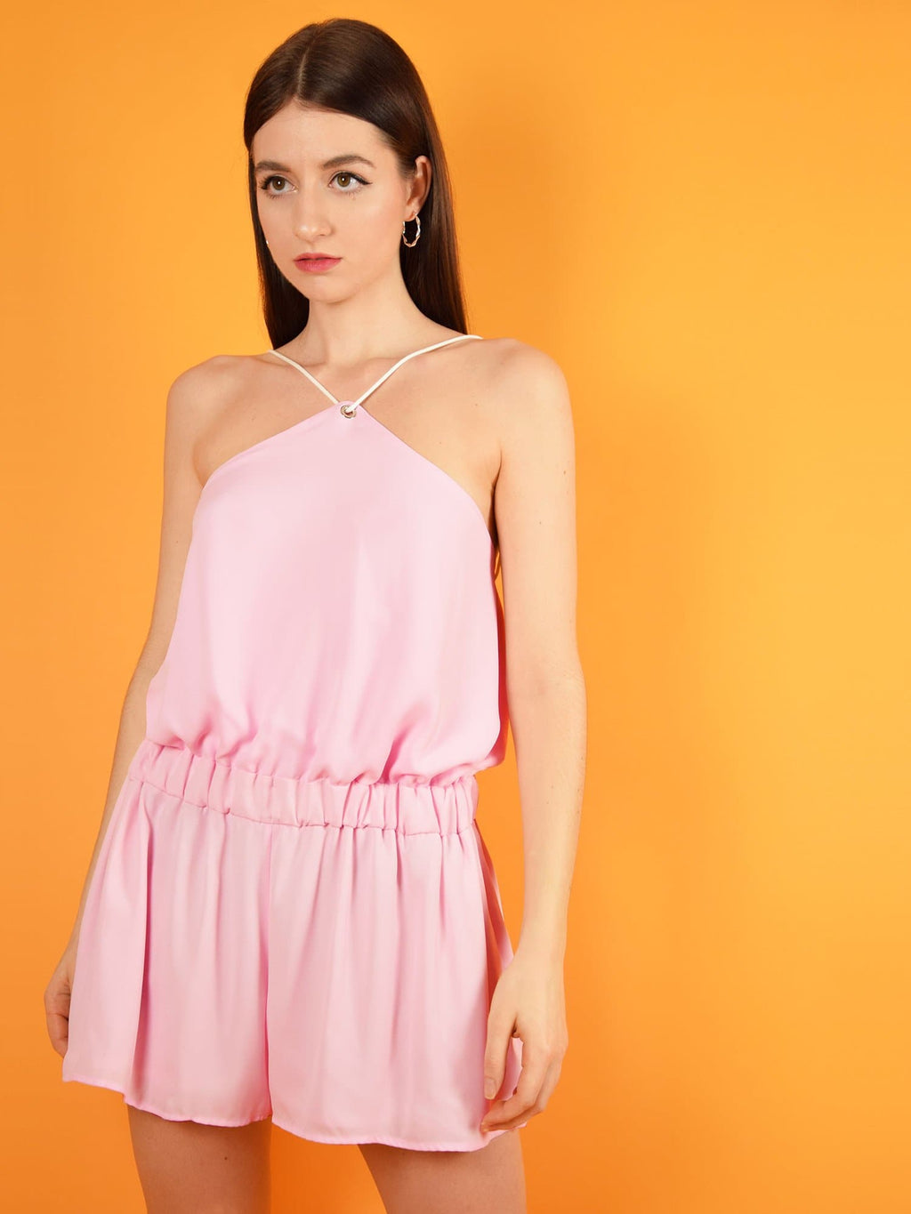 The desert dreams playsuit in pink is a summer jumpsuit with a short silhouette, loose fit and adjustable shoulder straps for a perfect fit.