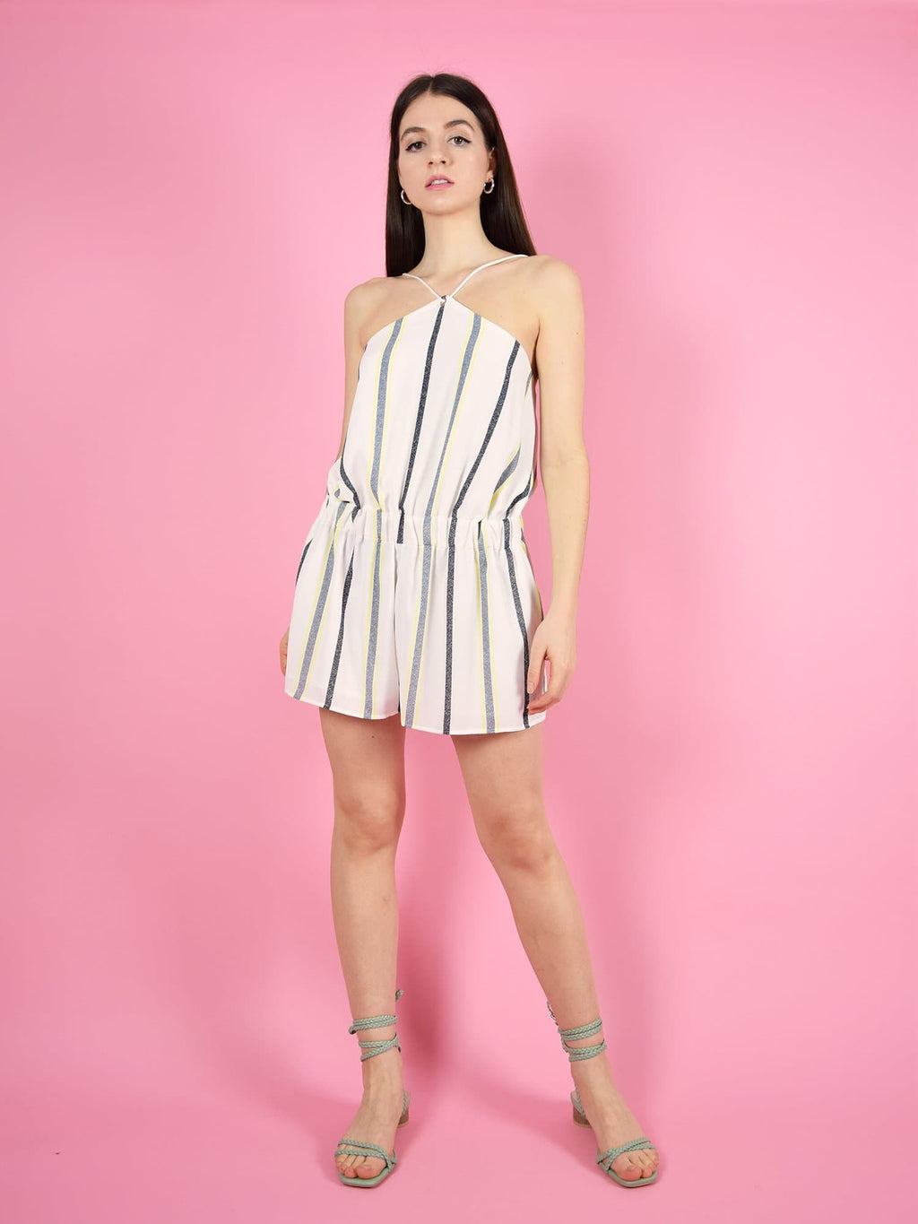 blonde gone rogue's desert dreams playsuit in white stripe is the perfect short jumpsuit for the summer. It is strapless, backless and has a loose, comfortable fit.