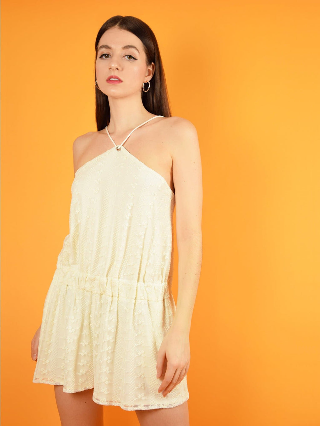 The desert dreams playsuit in white lace is a short, summer jumpsuit from white lace. It is semi backless and has a loose, comfortable fit.