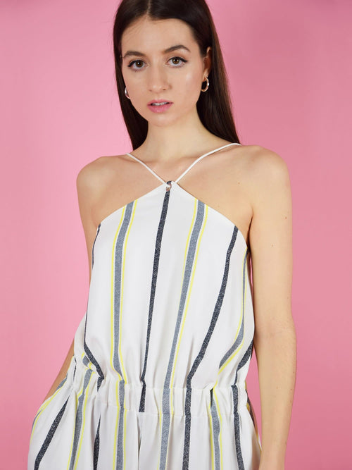 Close up of the desert dreams playsuit in white stripe. The adjustable shoulder straps guarantee perfect fit. The short summer jumpsuit is designed by blonde gone rogue.