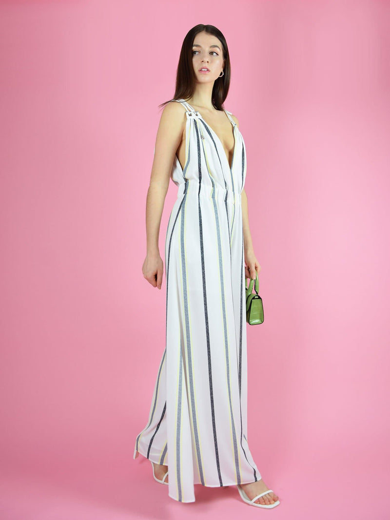 motion shot of the white eternal summer dressy jumpsuit by blonde gone rogue