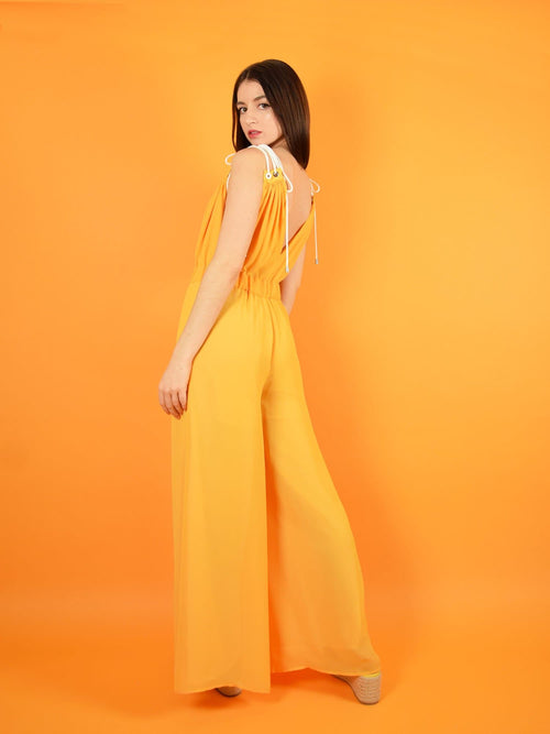 backshot of the eternal summer jumpsuit with adjustable shoulder straps for perfect comfort. design by blonde gone rogue.