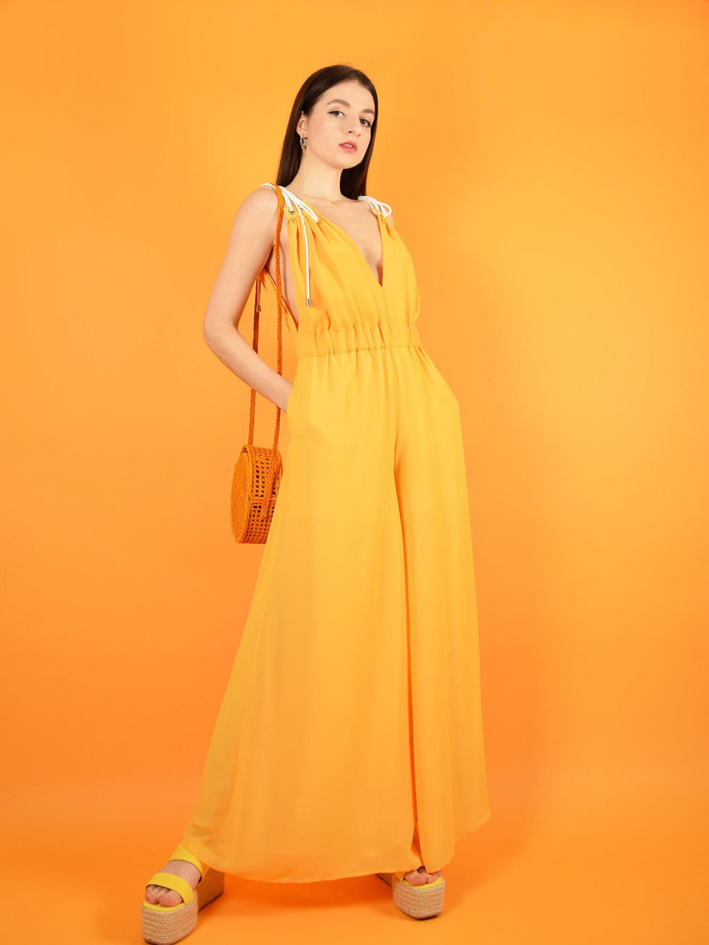the sustainable eternal summer jumpsuit in orange - wide leg dressy jumpsuit for weddings and formal occasions. design by blonde gone rogue.