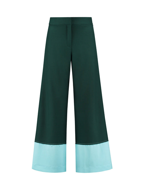 Dark green flared trousers with raw edge and light blue panel