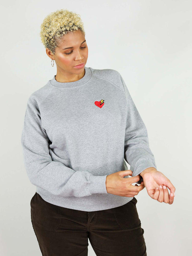 Grey heart organic sweatshirt is slightly oversized fit and incredibly soft, 100% organic cotton. Heart and thunder embroidery on the chest and raglan sleeves.