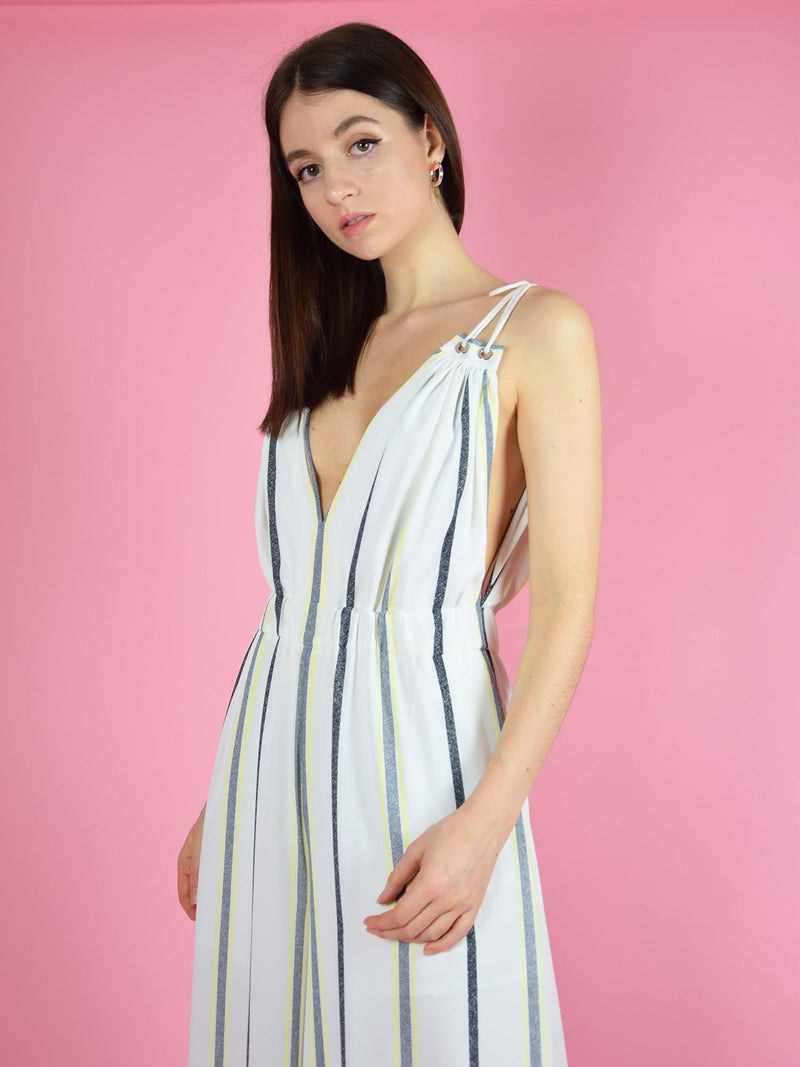close up of the sustainable eternal summer jumpsuit - it features a beautiful v-neck cleavage and adjustable shoulder straps
