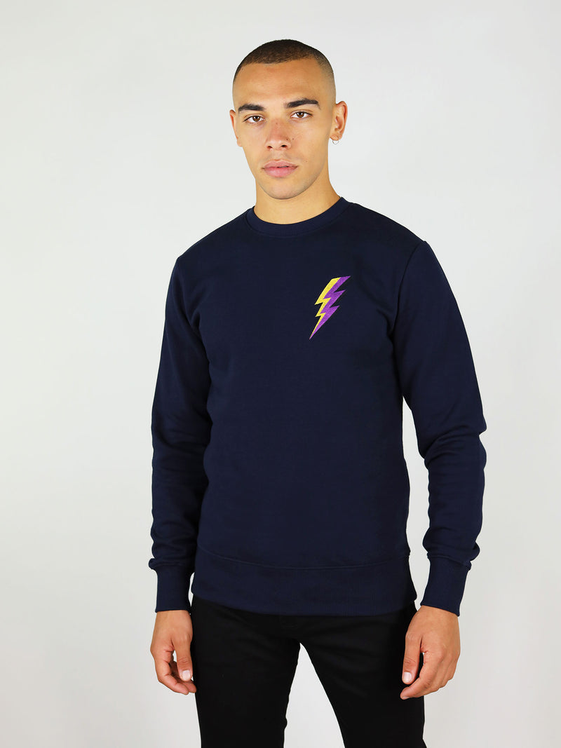 Thunder organic sweatshirt in navy blue has a thunder embroidery on the chest in purple and yellow and slightly oversized fit. It also has crew neck and raglan sleeves.