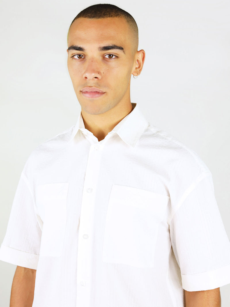 Sustainable white linen shirt with short sleeves by blonde gone rogue