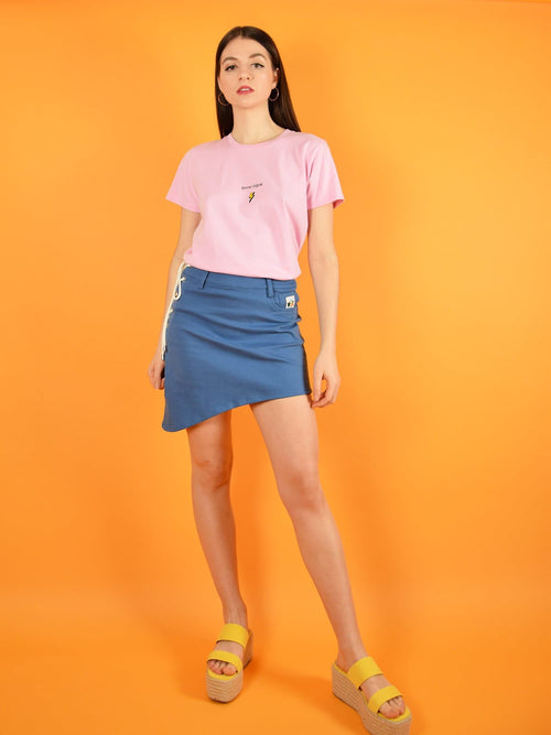 blonde gone rogue's pink organic cotton tee with print and lace up denim skirt which is a short a-line skirt with lace closing for optimal comfort.