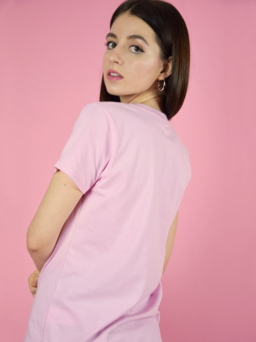 Backshot of a pink organic cotton tee.