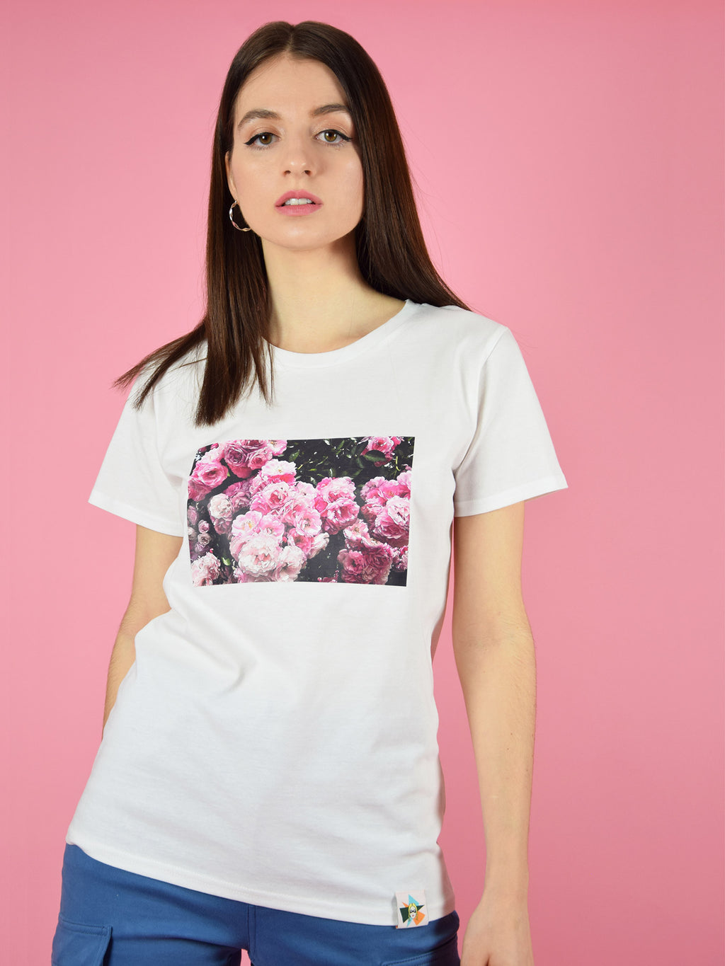The Rose Garden Organic Cotton Tee in white is a 100% GOTS certified organic cotton t-shirt with a cool, colourful print of roses in a garden.