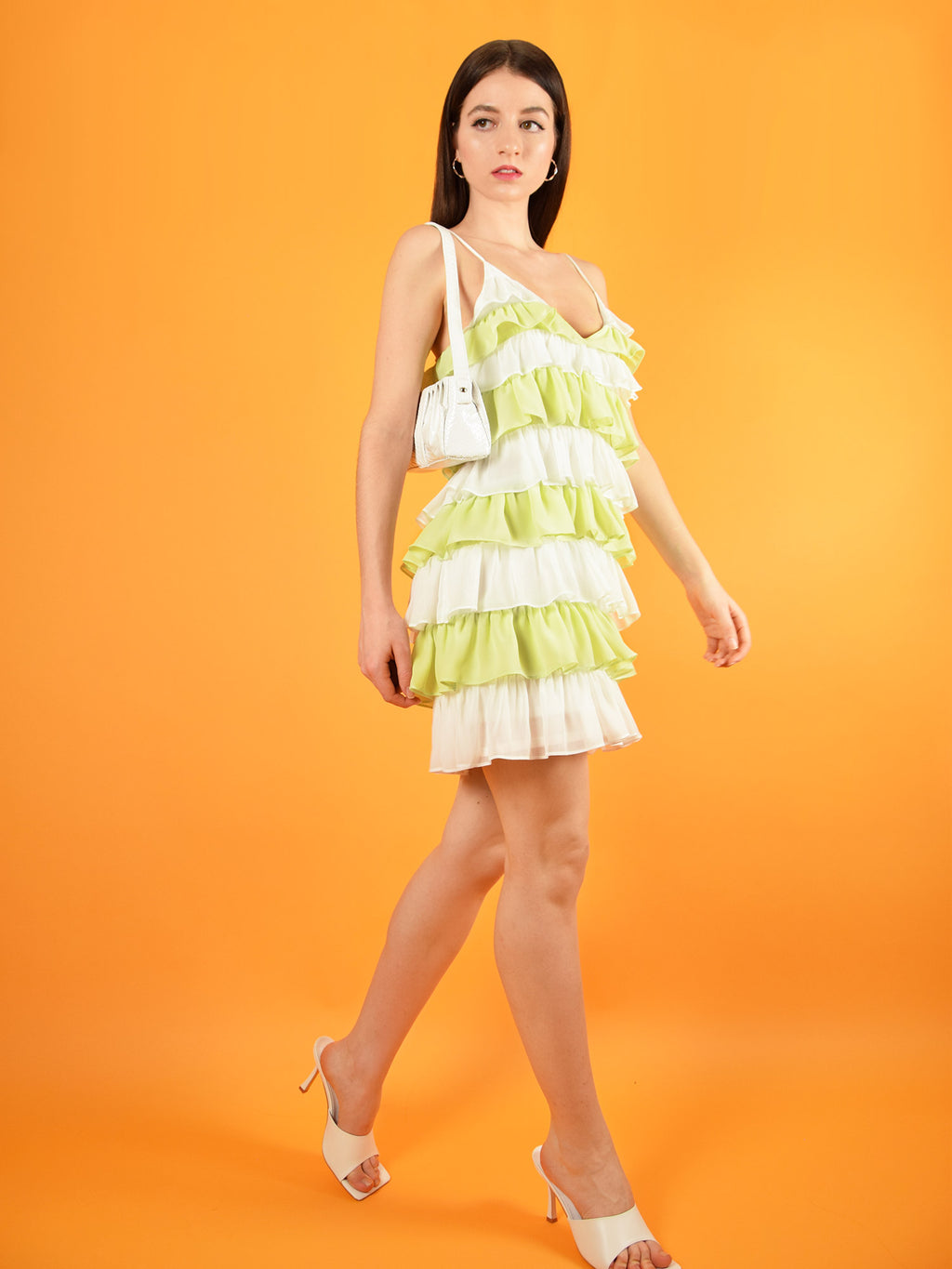 The summer affair mini dress by blonde gone rogue is a short dress with ruffle details all over it. It comes in white and yellow and features adjustable straps for a perfect fit. It's great for parties, cocktails and brunches.