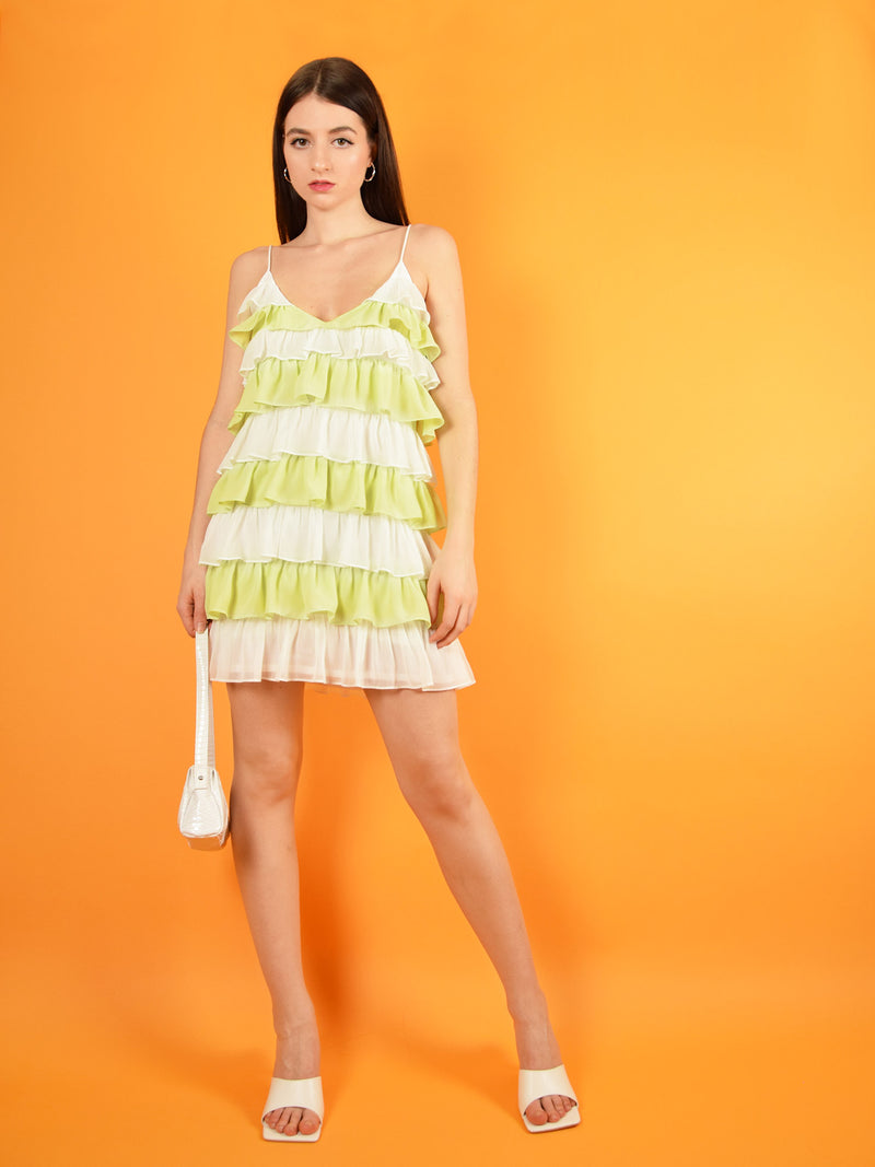 The summer affair mini dress in white and green is a cool party dress that features adjustable shoulder straps to ensure perfect fit. Design by blonde gone rogue.
