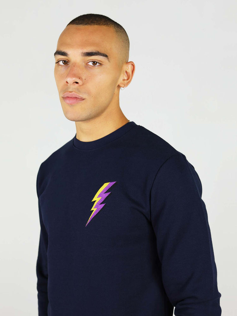 Navy blue thunder organic sweatshirt has soft touch as it is made from 100 organic cotton. It is made up of crew neck, raglan sleeves and thunder embroidery on the chest. It is comfortable, slightly oversized fit.
