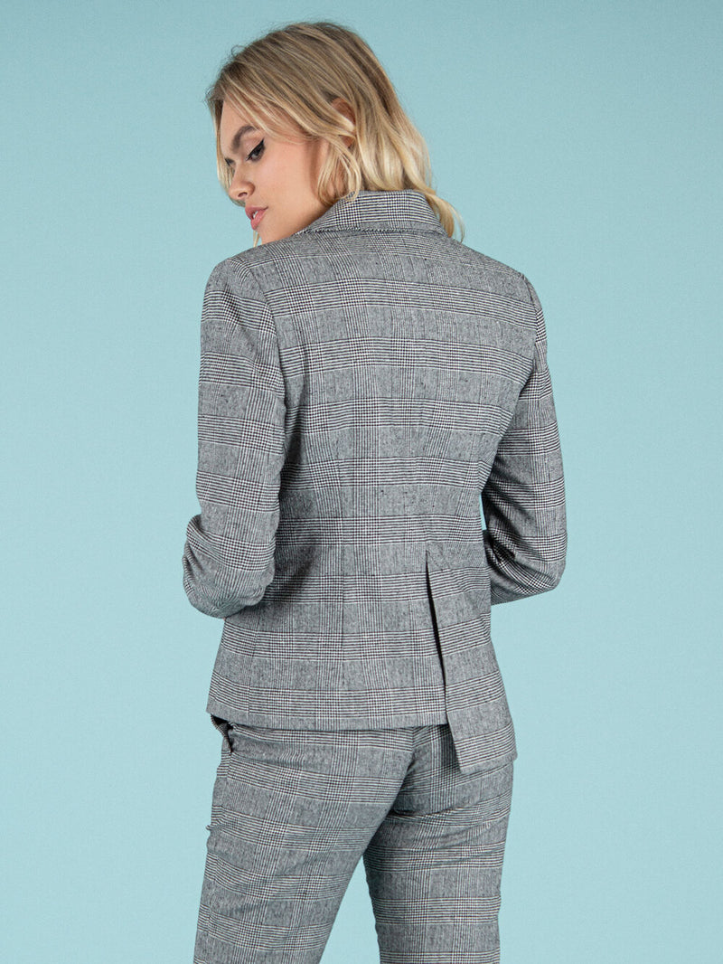 Backshot of a sustainable upcycled blazer in grey