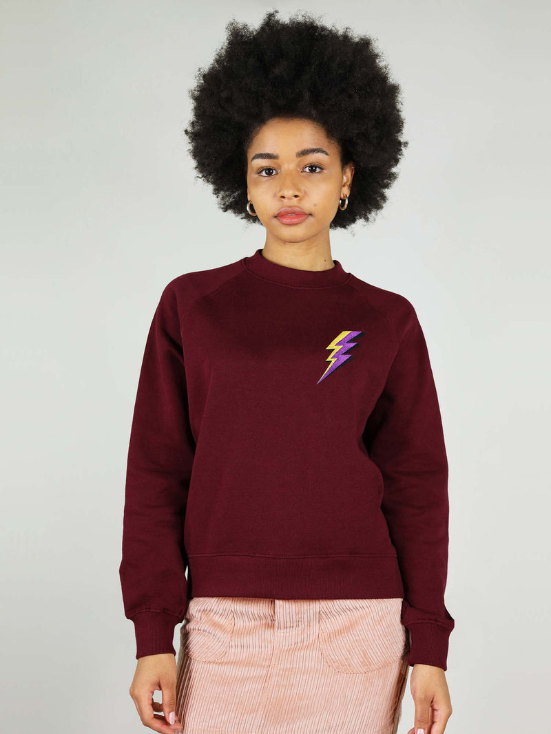 Deep burgundy thunder organic sweatshirt has crew neck and slightly oversized fit. Very warm and has raglan sleeves.