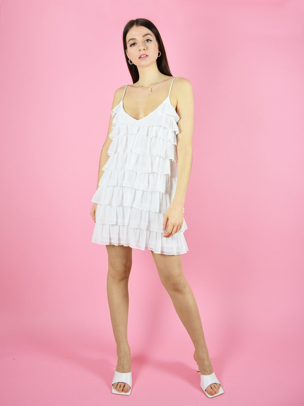 The white summer affair sustainable dress by blonde gone rogue is a party mini dress with unique design. It features adjustable shoulder straps.