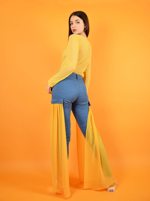 backshot of blonde gone rogue's skinny jeans with detachable veils in orange.