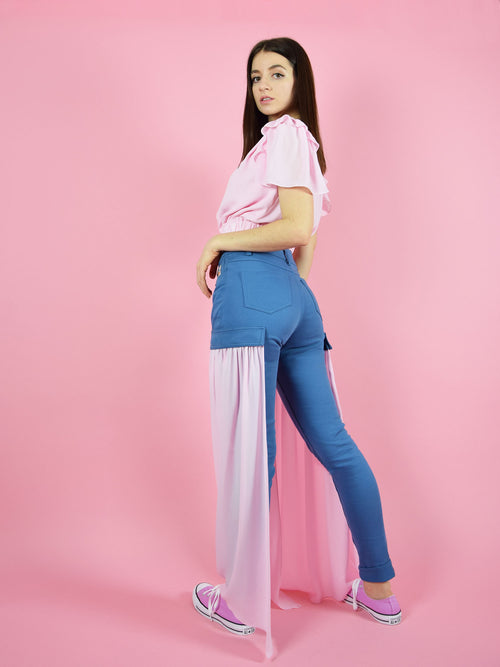 Backshot of blonde gone rogue's  wildflower skinny sustainable jeans with detachable veil detail in pink.