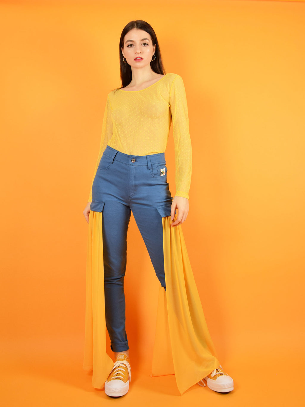 blonde gone rogue's daisy sustainable long-sleeve lace top and the wildflower skinny high waisted jeans with detachable veils in orange.