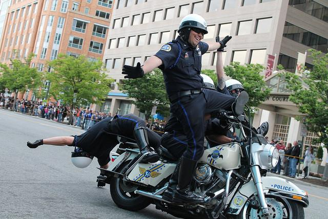 police officers having fun on motorcycle with taxpayer money