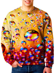 Model wearing Gratefully Dyed Apparel red, orange & rainbow bubbles unisex sweater.