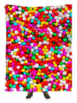 Hanging view of all over print rainbow candy sprinkles blanket by GratefullyDyed Apparel.