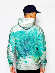 Model wearing blue splotches on white pullover hoodie with mandala art