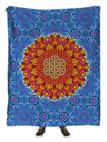 Hanging view of all over print blue & orange flower of life sacred geometry mandala blanket by GratefullyDyed Apparel.