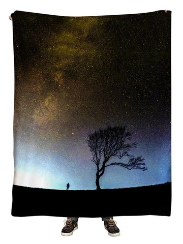 Hanging view of all over print gray galaxy with black tree blanket by GratefullyDyed Apparel.