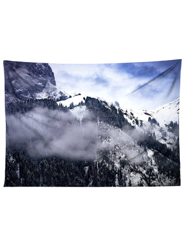 Horizontal hanging view of all over print black & blue forest mountain tapestry by GratefullyDyed Apparel.