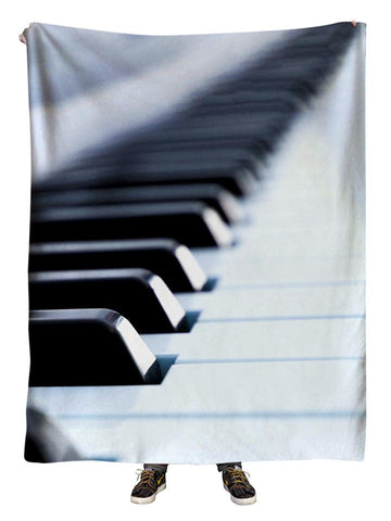 Hanging view of all over print black & white piano blanket by GratefullyDyed Apparel.