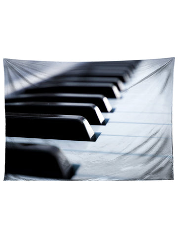 Vertical hanging view of all over print black & white piano tapestry by GratefullyDyed Apparel.