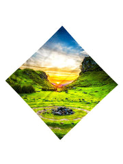 Sun setting behind green hills all over print bandana flat view