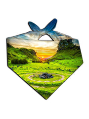 Sun setting behind green hills all over print bandana