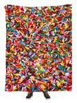 Hanging view of all over print rainbow chocolate sprinkles blanket by GratefullyDyed Apparel.