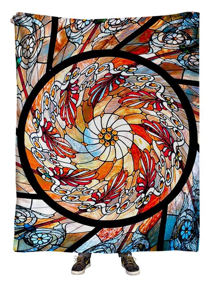 Hanging view of all over print red, orange & white stained glass mandala blanket by GratefullyDyed Apparel.
