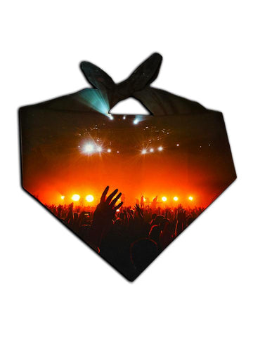 Bright red concert lights with crowd silhouette bandana