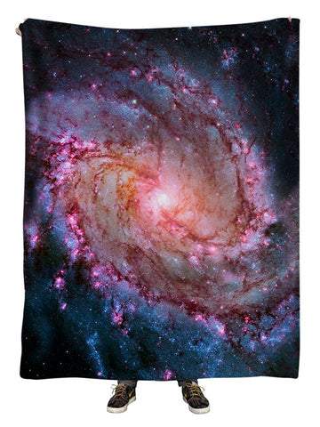 Hanging view of all over print pink spiral galaxy blanket by GratefullyDyed Apparel.
