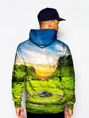 Model In Vivid Sunset Over Green Landscape Pullover Hoodie Back View