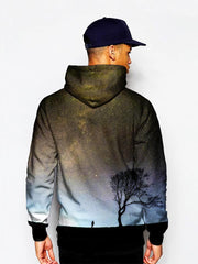Model wearing silhouette of man and tree in space all over print pullover hoodie back view